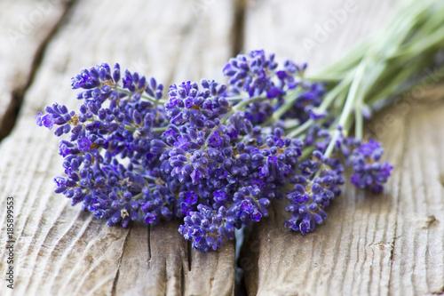 Fotobehang Lavendel Bunch of lavender flowers on old wooden background