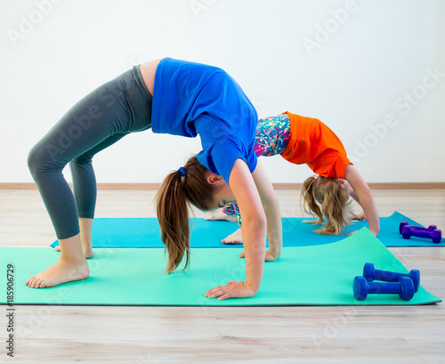 Foto op Aluminium School de yoga Kids doing exercises