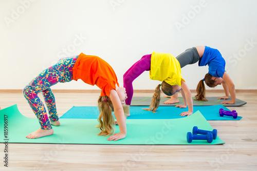 Fototapeta Kids doing exercises
