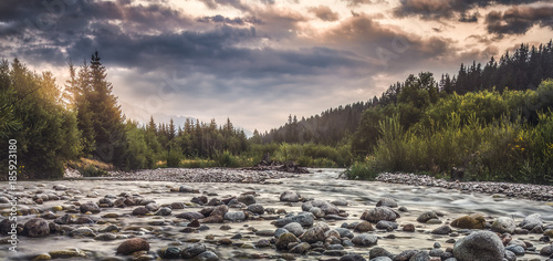 Papiers peints Rivière de la forêt Bela River with Water Flowing over the Rocks at Sunset in Slovakia