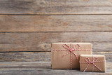 Brown gift boxes on grey wooden table - 185928303