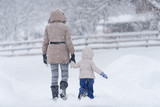 Mother with her little girl in snow - 185936131