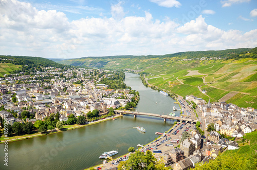Vineyard Moselle Valley Germany: View from Landshut Castle to the old town Bernkastel-Kues with vineyards and river Mosel in summer, Europe
