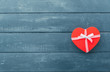 Heart gift box with ribbon on wooden table. Happy valentines day concept