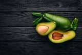 Avocado on a wooden background. Top view. Free space for your text. - 185971368