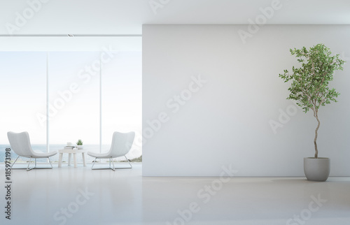 Leinwandbild Motiv Indoor plant on white floor with empty concrete wall background, Lounge and coffee table near glass window in sea view living room of modern luxury beach house or hotel - Home interior 3d illustration