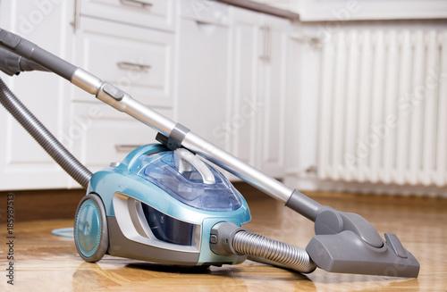 Vacuum Cleaner On Kitchen Floor