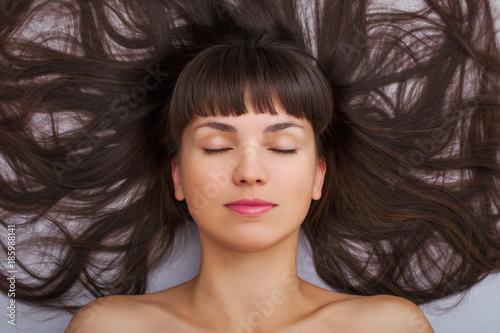 Deurstickers Kapsalon Beauty portrait of woman girl closed eyes. Top view.