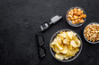 Cinema food. Crisp, popcorn, rusks near glasses on black background top view copyspace