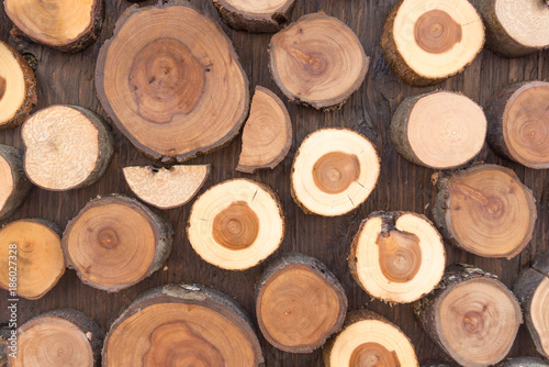 Natural wooden background - closeup of chopped firewood. - 186027328