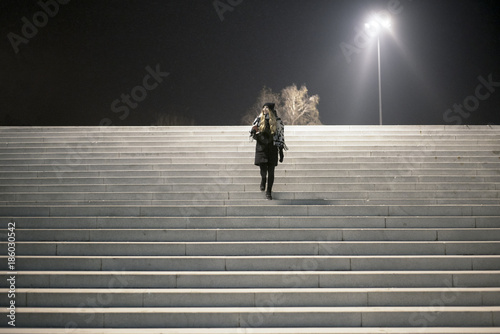 The woman down the stairs under the street lights