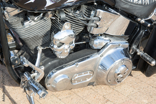 Staande foto Fiets chrome motor of vintage motorcycle in street