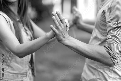 Man and woman hold hands, performing a dance at the festival