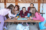 Happy family at home in the couch playing classic table games . - 186054506