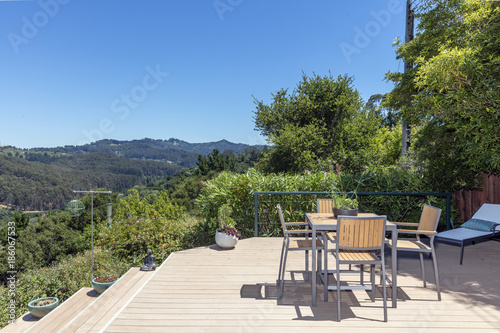 Amazing Patio Wooden Deck With Outdoor Furniture And Mountain View At Daytime