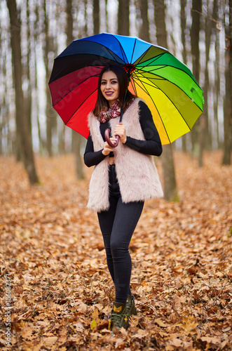Woman with umbrella in the forest