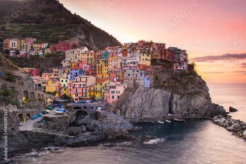 Foto op Canvas Lichtroze amazing town of manarola at sunrise, italy