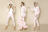 Beautiful sexy blonde woman wearing a pajama, a bunny costume, smiling happily. Fashion model on a beige background in  Easter bunny costume. - 186123956