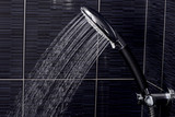 chrome shower head with flowing water - 186129504