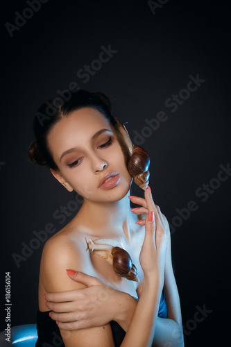 Foto op Canvas Kapsalon Attractive young girl with snails on face