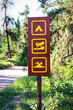 A camping, boat launch and swimming sign