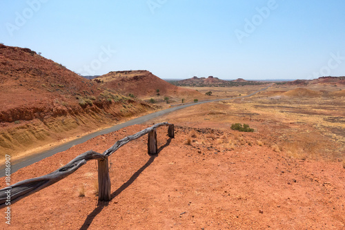 Fotobehang Koraal Old boundary fence and road at Cawnpore Lookout in Outback Queensland