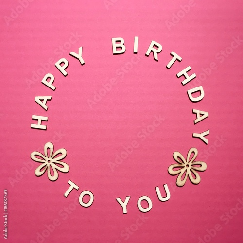 Happy birthday to you made of wooden letters on a pink background - 186187569