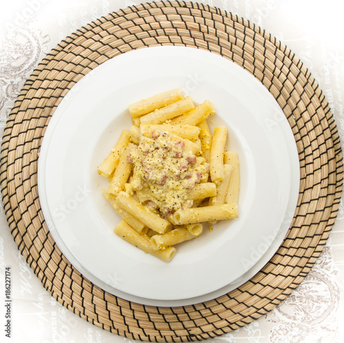 white dish with penne and carbonara sauce - 186227174