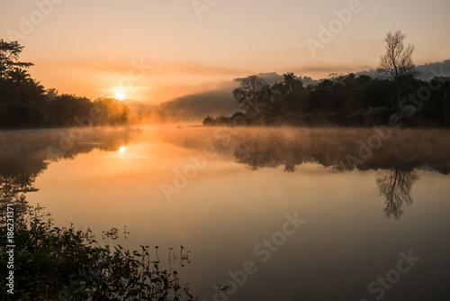 Fototapeta Sunrise on the river with misty