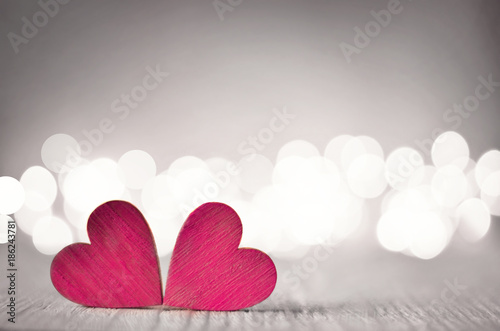 Foto Murales Hearts on a wooden table and background is a bokeh.