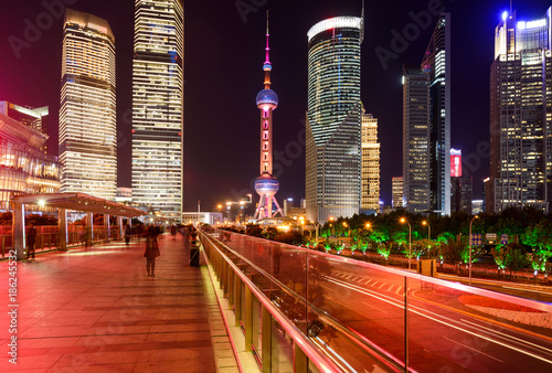 Foto op Plexiglas Shanghai Shanghai Night - With its glittering modern skyscrapers and, bright and colorful streets, Lujiazui has became a popular night time tourist attraction in Shanghai, China.