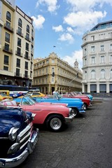 Classic American cars parked in Downtown Havana, Cuba.