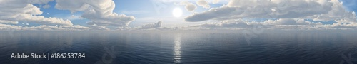 panorama of the sea sunset. the sun over the water under the sky with clouds. banner.  - 186253784