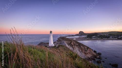 Foto op Aluminium Strand Sunset time-lapse over Castlepoint Lighthouse, Wairarapa, New Zealand
