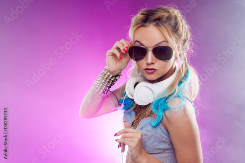 Young fashionable girl in disco style. Listening music and enjoying. Retro style - 186295734