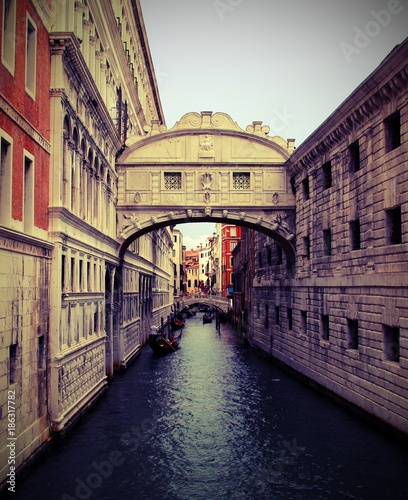 Venice in Italy Ancient Bridge of Sighs and ancient Ducal Palace with old effect - 186317782