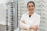 Posing optometrist woman in eyeglasses store smiling looking at camera - 186331368