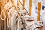Old fashioned harbor marina sailboat ropes - 186332350