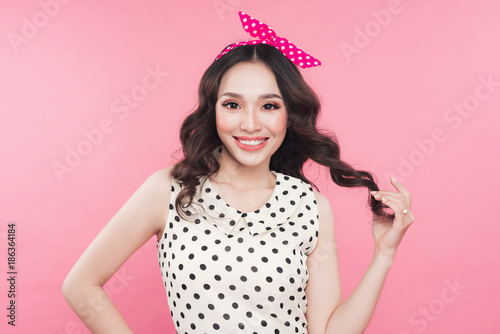Deurstickers Kapsalon Portrait of a young woman over pink background.