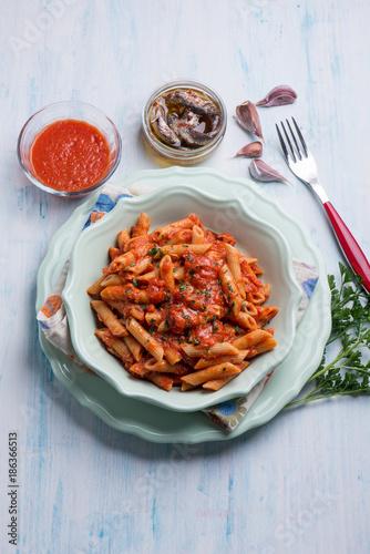 Aluminium Hot chili peppers pasta with tuna anchovyand tomatoes sauce