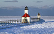 Great Lakes lighthouse surrounded by a frozen solid Lake Michigan.
