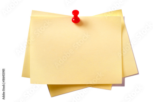 Foto Murales Yellow sticky post notes with pin isolated on white
