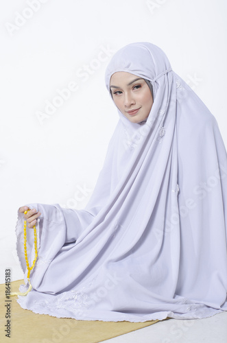 young woman wear shawls for prayer and hand holding beads