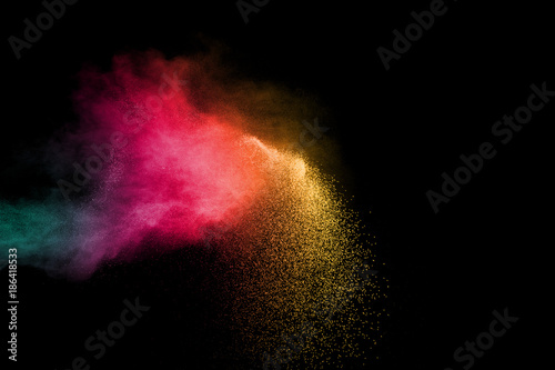 abstract color powder explosion on black background.abstract  Freeze motion of color dust or particles splash. - 186418533