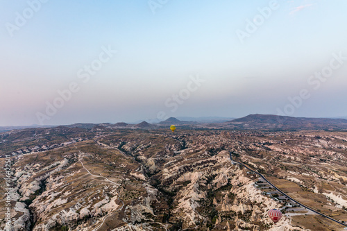 Foto op Plexiglas Cappuccino Balloon over the landscape on sunrise
