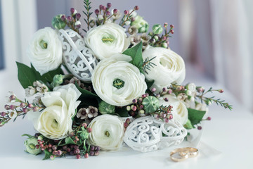 Beautiful white wedding bouquet with rings