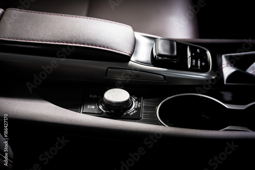 Media and navigation control buttons of a Modern car. Car interior details. White leather interior of the luxury modern car. Modern car interior - 186427170