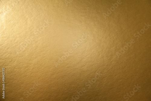 Tekstura złotym tle metalicznej papieru dla projektu Christmas lub nowy rok karty partii