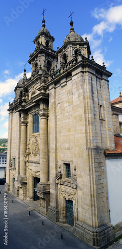 Aerial view of the facade of the parish church of Santiago in neoclassical style with baroque reminiscences built in granite stone in a village called Pontedeume in La Coruna, Spain. With a blue sky