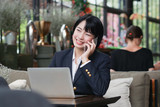 Asian business girl working and drinking coffee in cafe - 186435552
